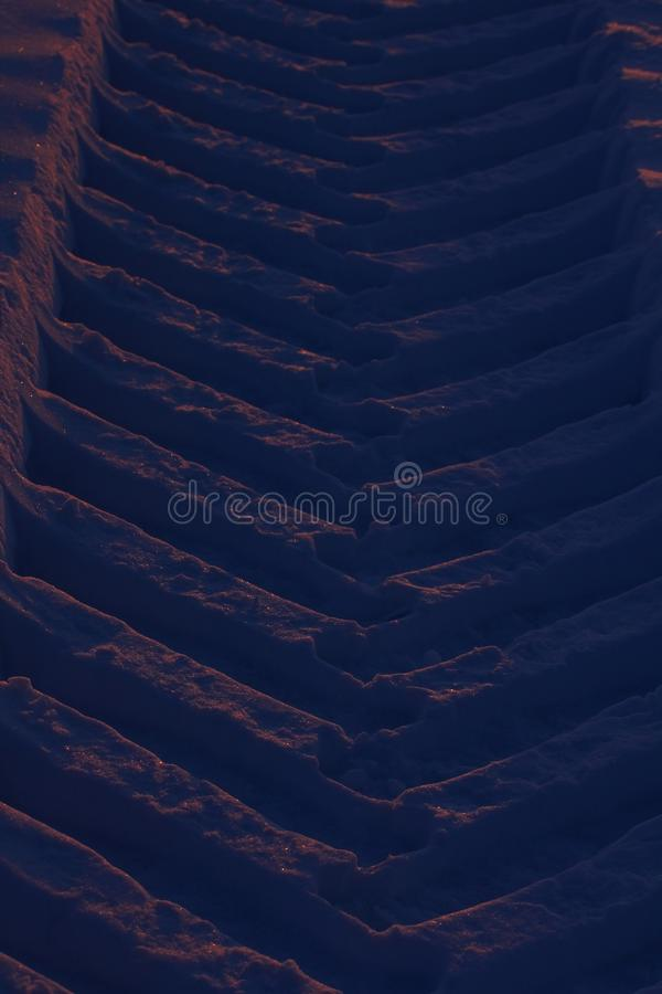 Car wheel track in snow stock photography