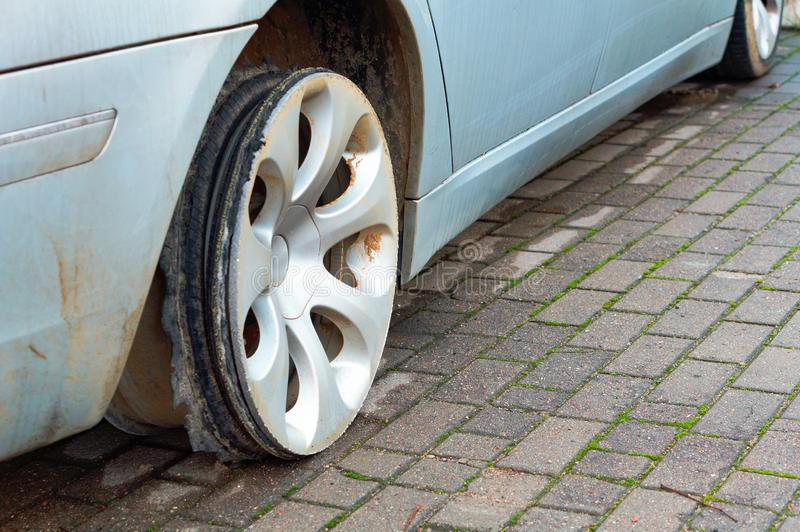 The torn rubber on the wheel of a car, car wheel without the tyre stock images
