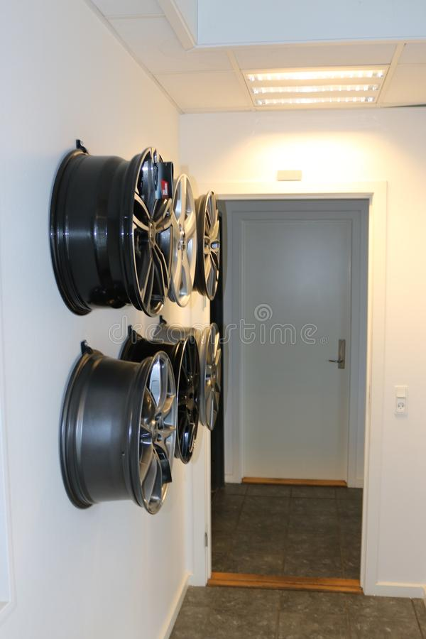 Car wheels hanging on a wall. stock images