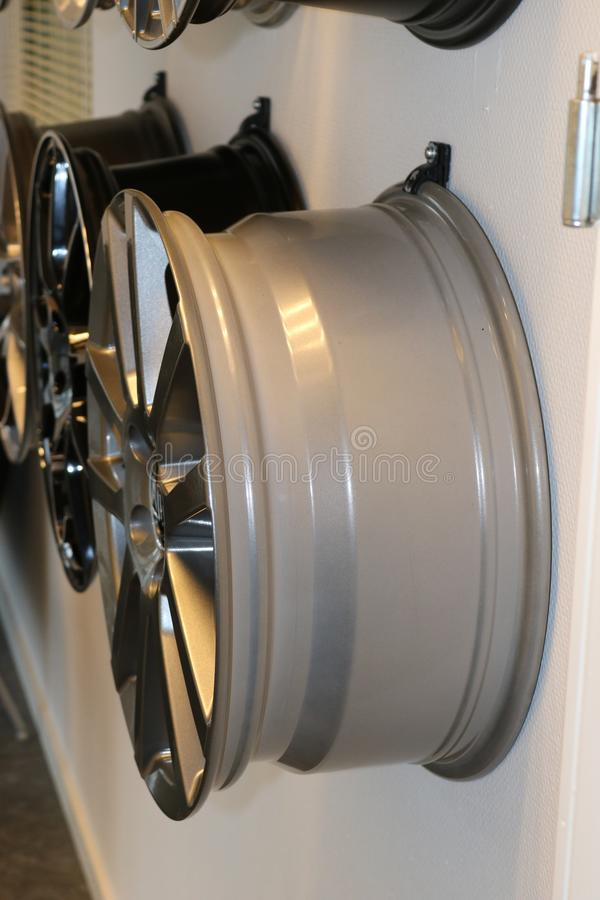 Car wheels hanging on a wall. royalty free stock image