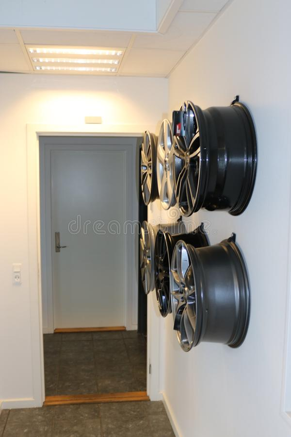 Car wheels hanging on a wall. royalty free stock photos