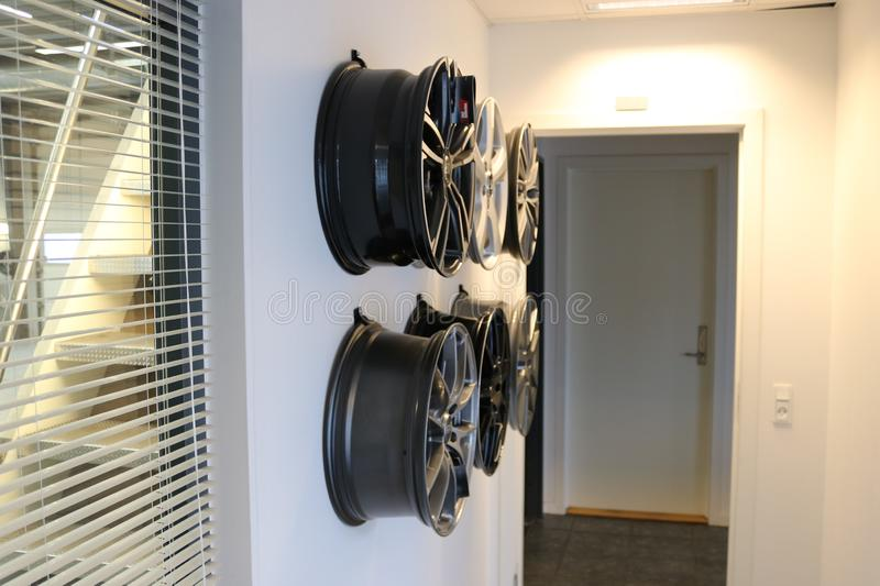 Car wheels hanging on a wall. stock photos