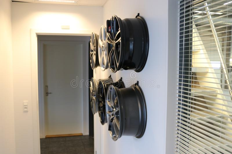 Car wheels hanging on a wall. stock photography