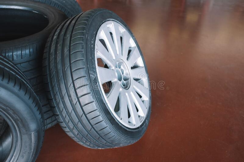 Car wheels maintenance in mechanical workshop royalty free stock images