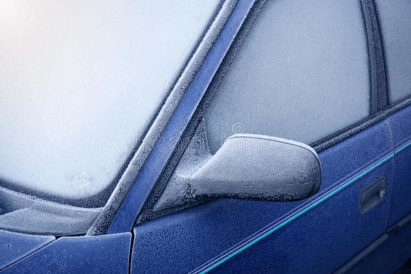 Car window and side mirror covered with ice in the stock photography