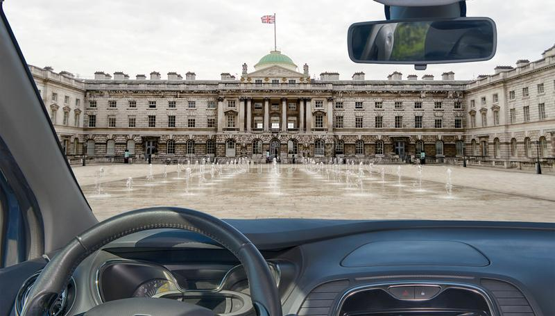 Car windshield with view of Somerset House, London, UK stock image