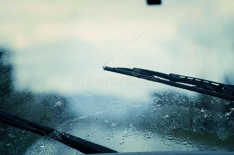 Car windshield wipers. Car windshield wipers in the rainy weather. traffic jam royalty free stock images