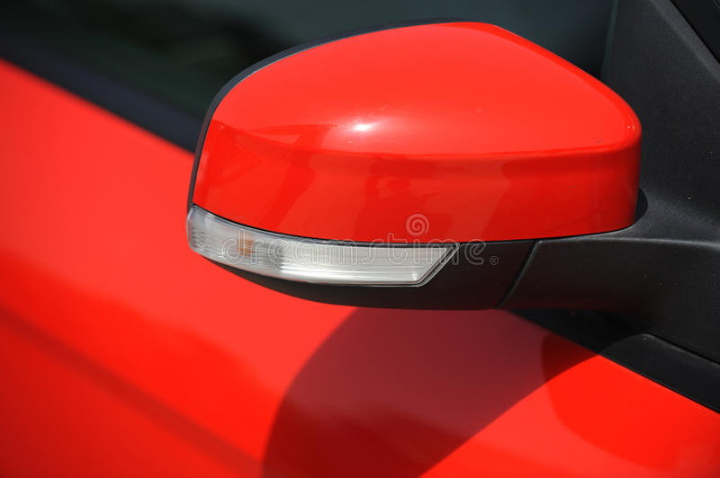 Car Wing Mirror. A red car Wing Mirror royalty free stock images