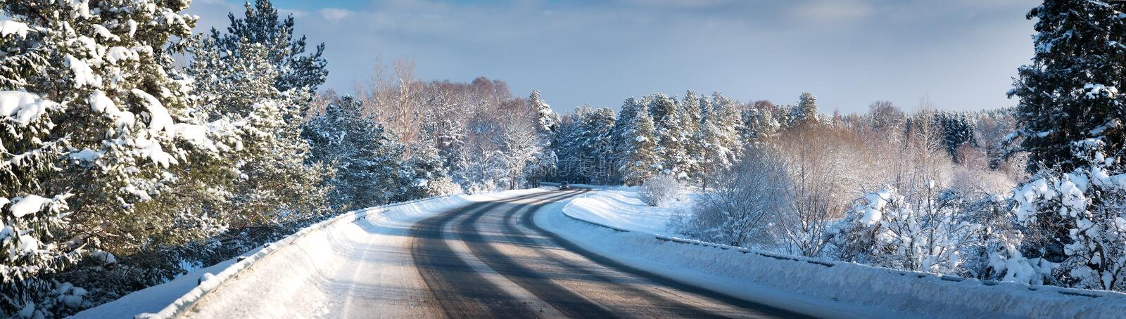 Car on winter road. Covered with snow stock images