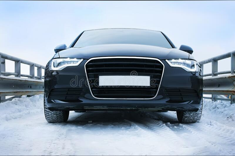 Car in winter on road. Prestigious car in the winter on the snow road stock image