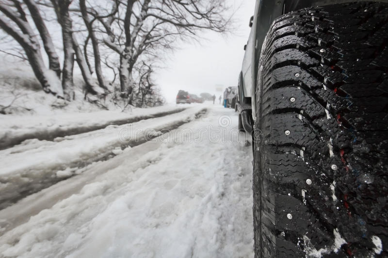 Car with winter tire stock photography