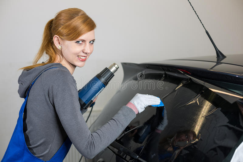 Car Wrapper Tinting Car Window In Garage With A Tinted Foil Or Film Stock Photos