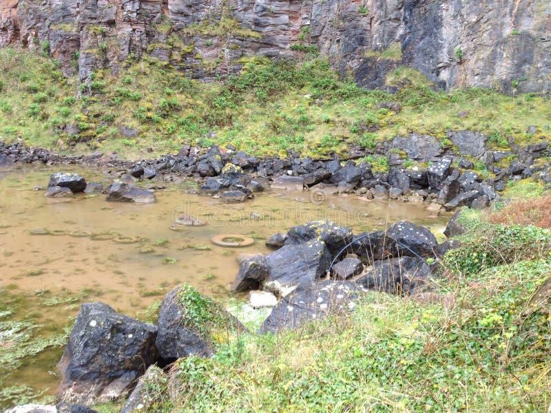 Car wreck Brixham quarry pond stock photos
