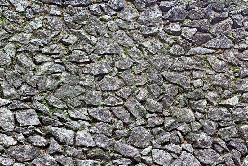 Cara áspera da parede de pedra imagem de stock royalty free
