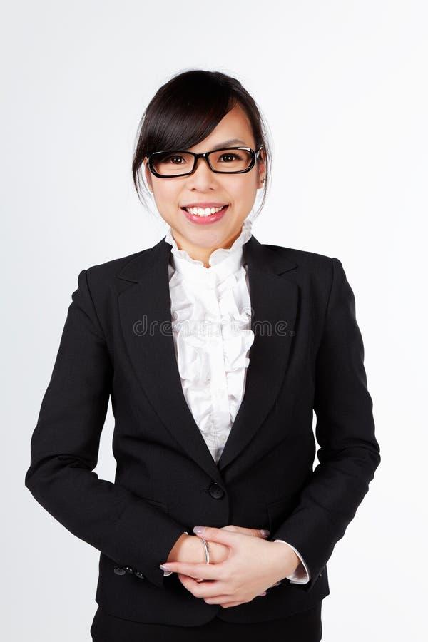 Cara asiática do sorriso da mulher no branco foto de stock royalty free
