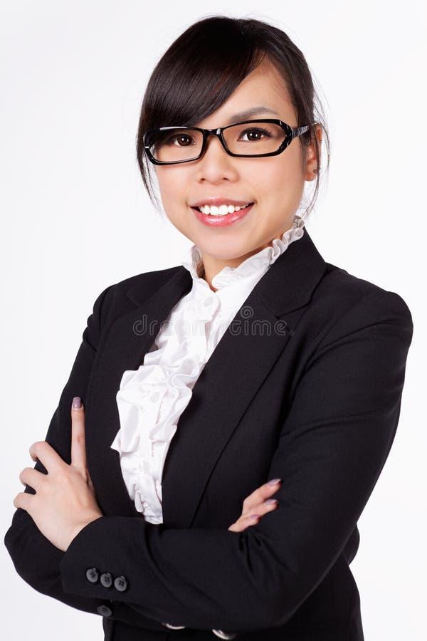 Cara asiática do sorriso da mulher no branco imagem de stock