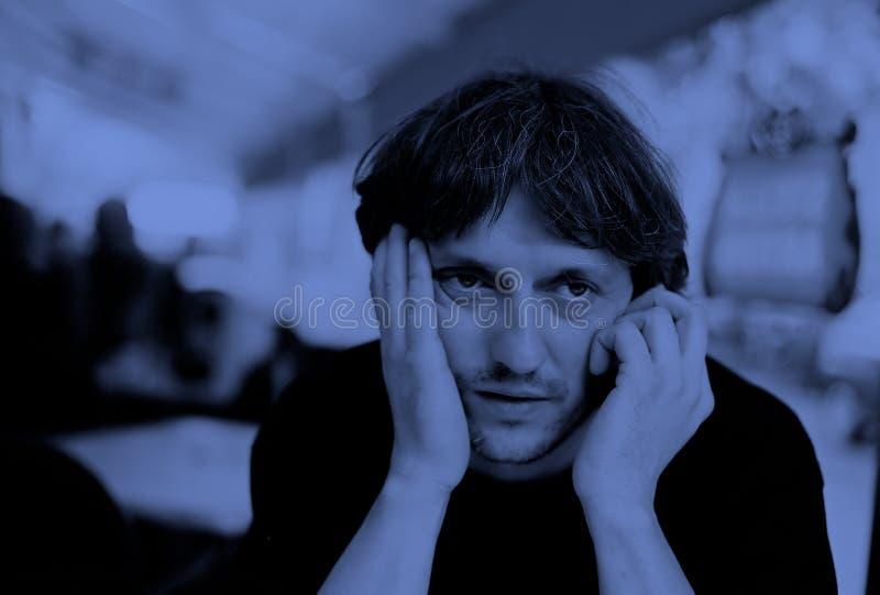 Cara/azul tristes de Feelin fotos de archivo