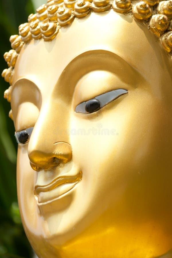 Cara budista dourada da estátua imagem de stock