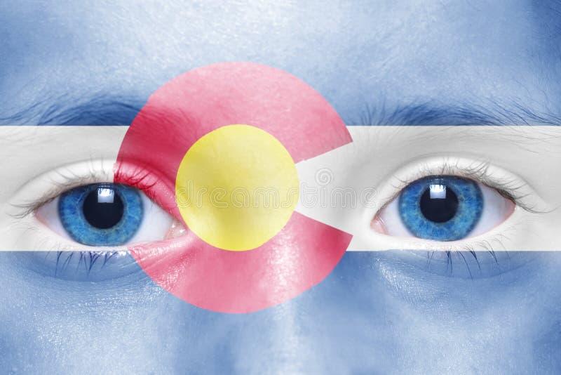 Cara com a bandeira do estado de Colorado foto de stock royalty free