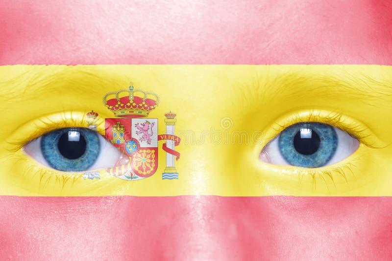 cara con la bandera española imagen de archivo