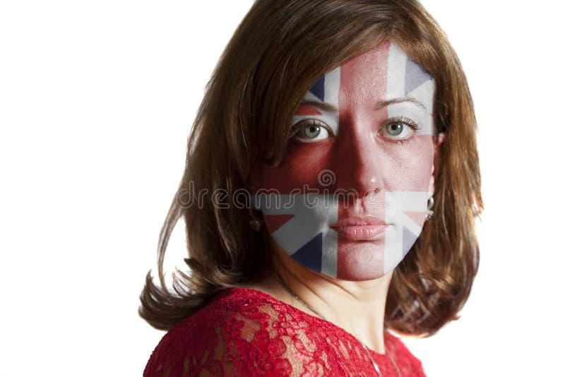 Cara da mulher com a bandeira britânica pintada imagem de stock