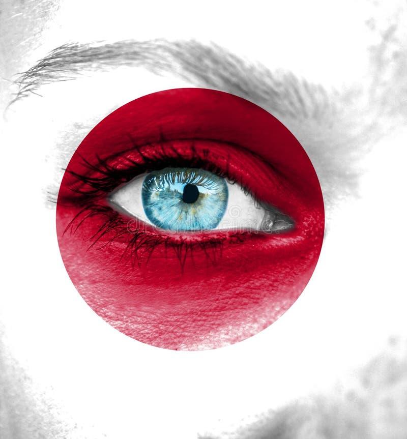 Cara da mulher pintada com a bandeira de Japão foto de stock royalty free