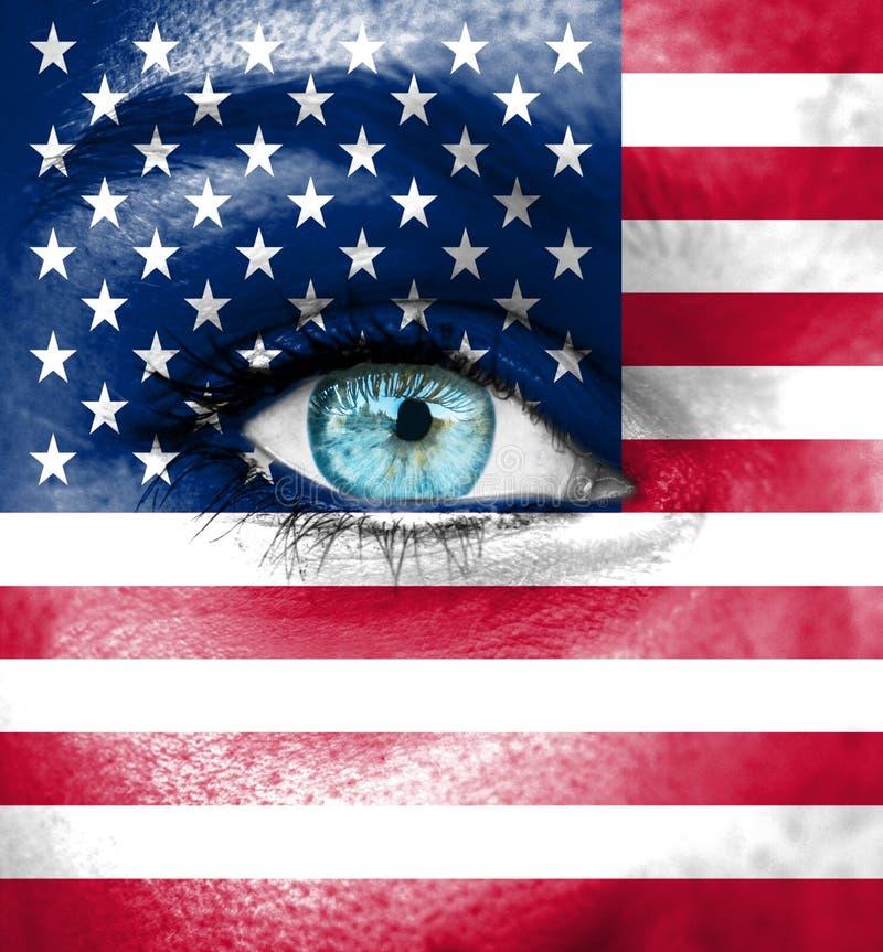 Cara da mulher pintada com a bandeira dos EUA imagem de stock