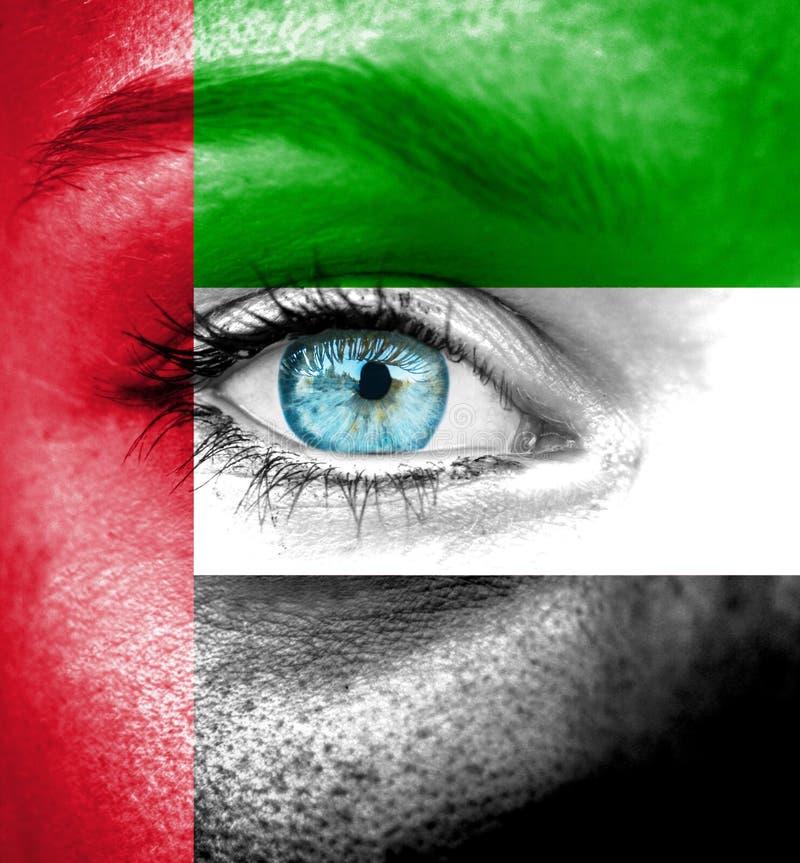 Cara da mulher pintada com a bandeira dos UAE imagens de stock royalty free