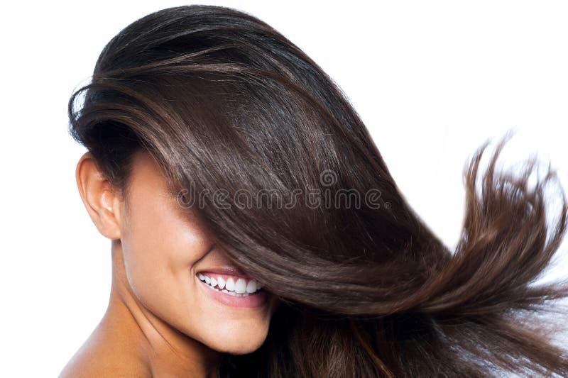 A cara da senhora coberta com o cabelo reto longo imagens de stock royalty free