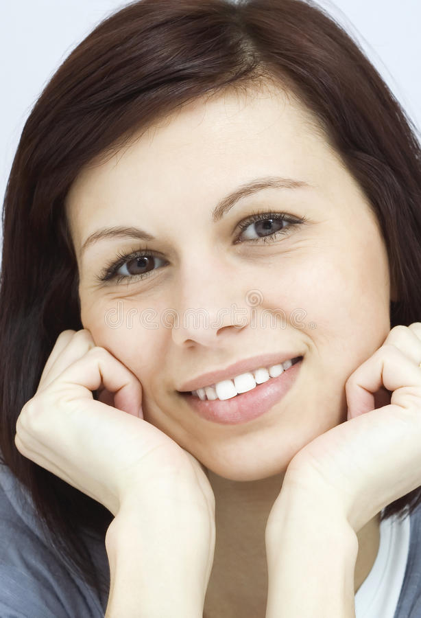 A cara das jovens mulheres imagem de stock
