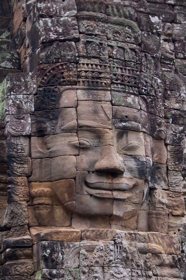 Cara de Avalokitesvara no templo de Bayon, Camboja imagens de stock