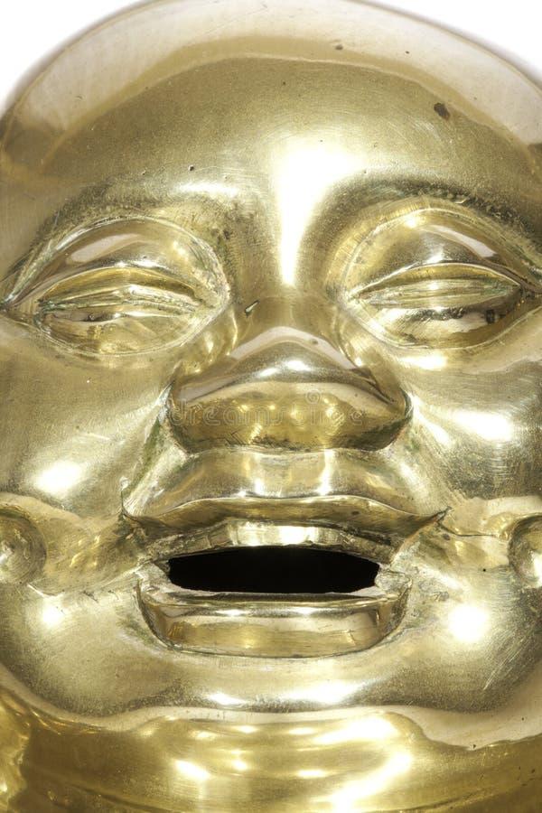 Cara de bronze da Buda com expressão de riso foto de stock