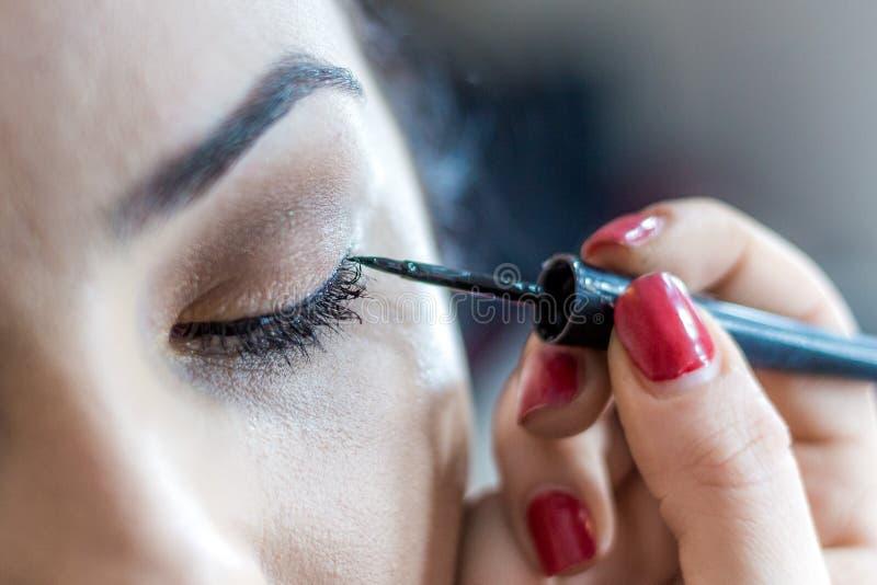 Cara de la hembra del maquillaje Cejas, ojos y pelo imagen de archivo