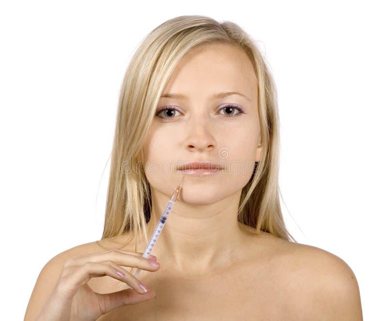 Cara de la inyección rubia joven de la mujer + del botox fotografía de archivo