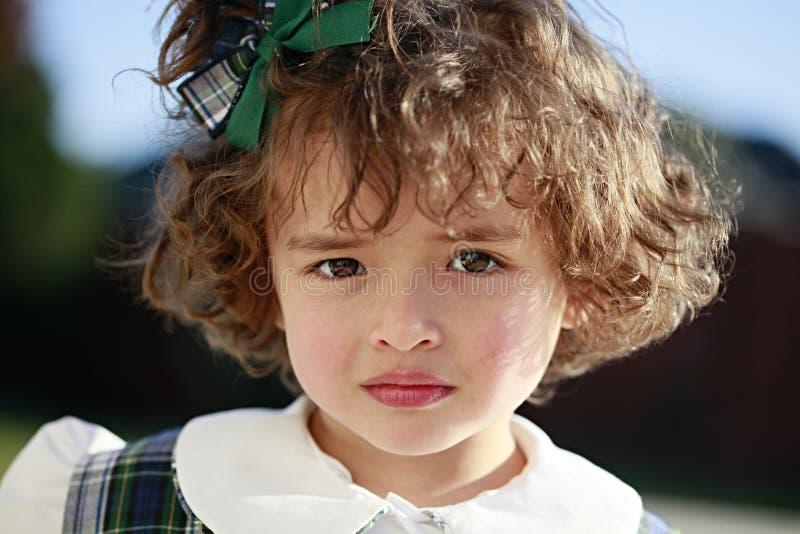 Cara de la muchacha de la escuela en uniforme imagenes de archivo