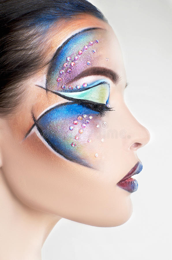 Cara de la mujer con maquillaje colorido fotografía de archivo