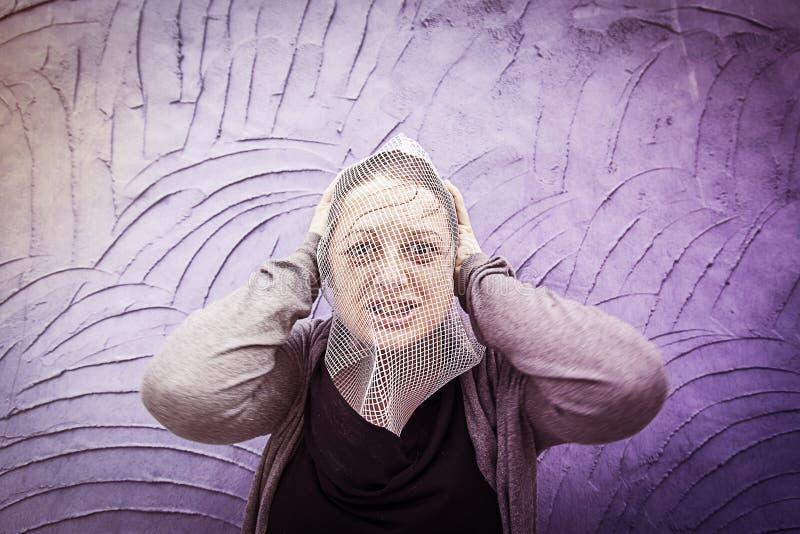 Cara de la mujer cubierta imagen de archivo libre de regalías