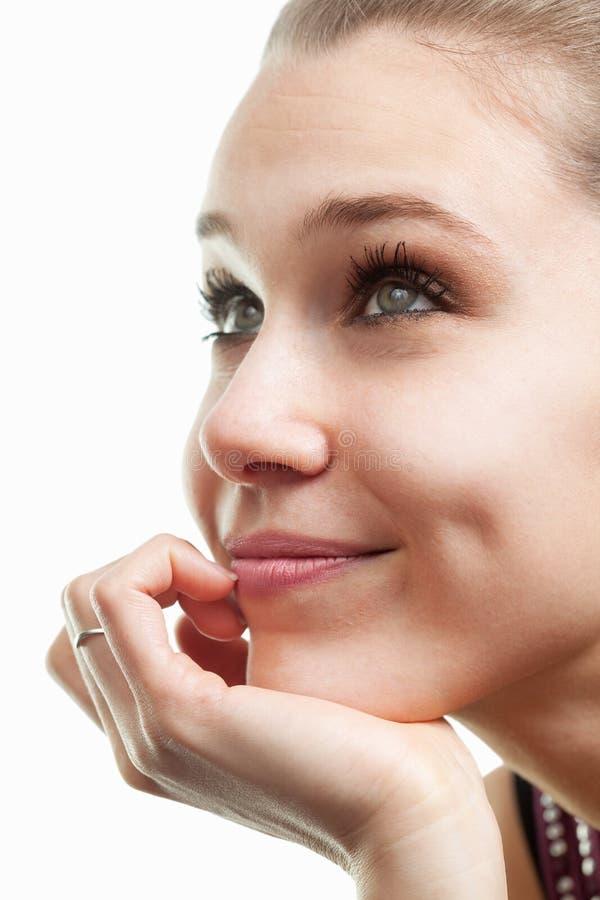 Cara de la mujer hermosa feliz aislada en blanco imagen de archivo