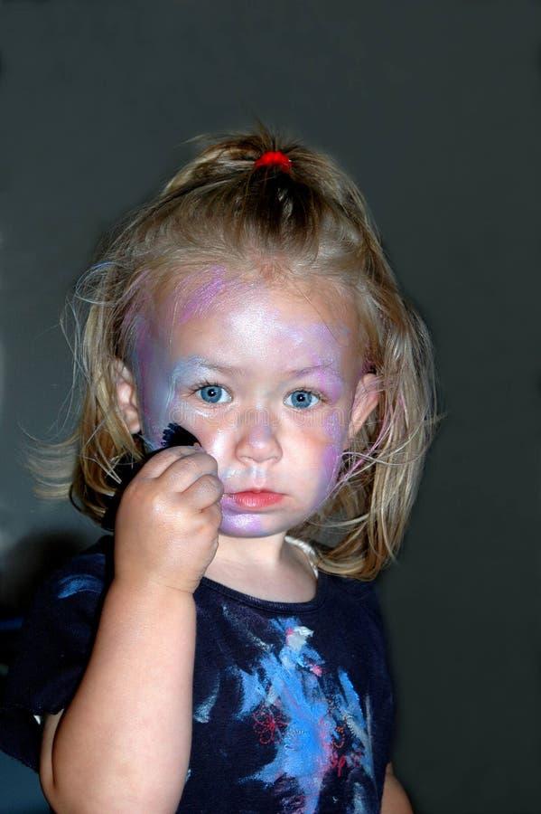 Cara de la pintura del niño fotos de archivo