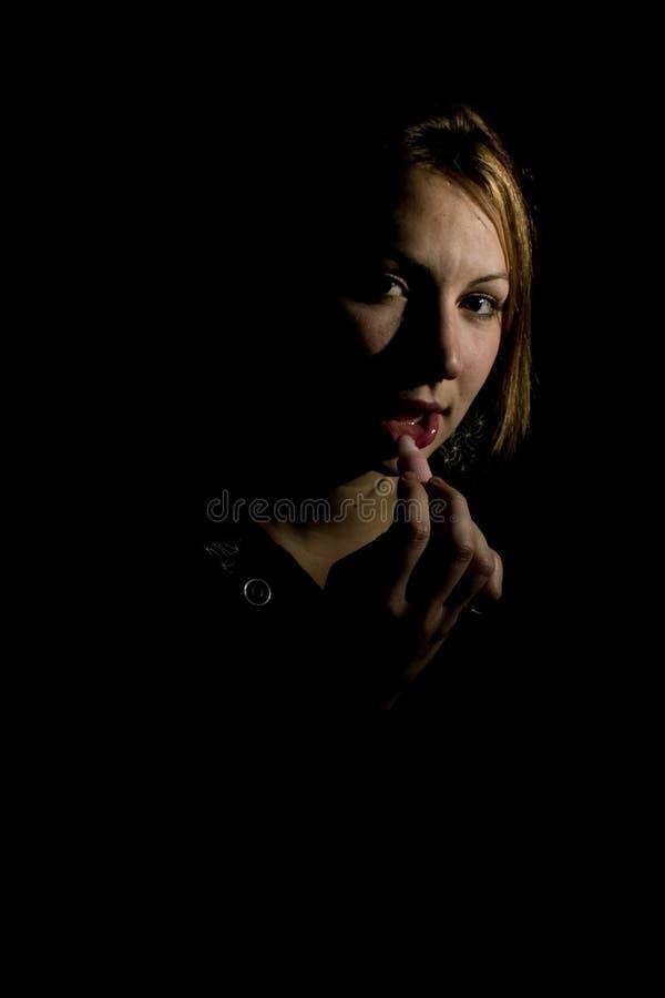 Cara de la sombra con lustre del labio imagenes de archivo