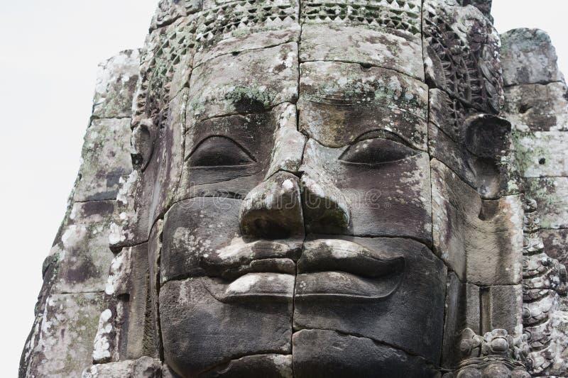Cara de pedra antiga no templo de Bayon fotografia de stock