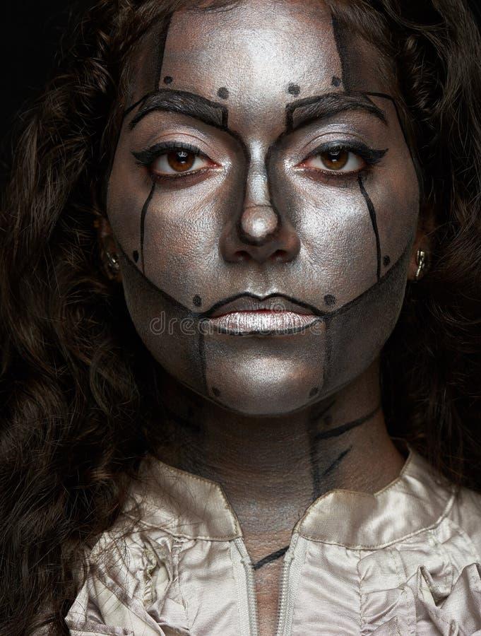 Cara de prata das mulheres do metal imagem de stock royalty free