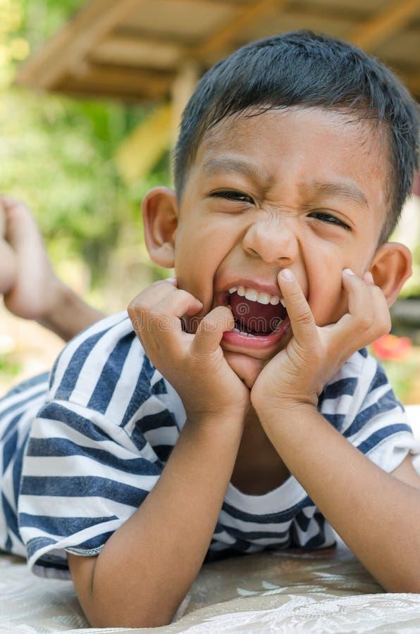 Cara de sorriso do fim asiático da criança acima fotografia de stock