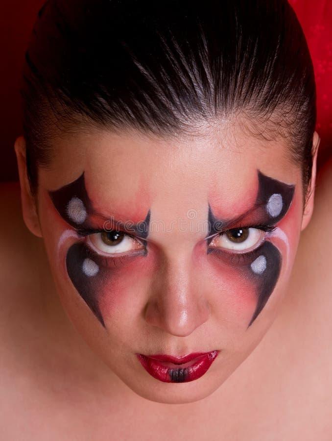 Cara de una mujer con la pintura de carrocería como araña. fotografía de archivo