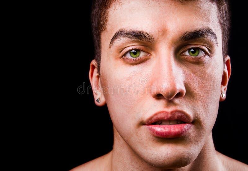Cara del hombre sensual hermoso aislado en negro imágenes de archivo libres de regalías