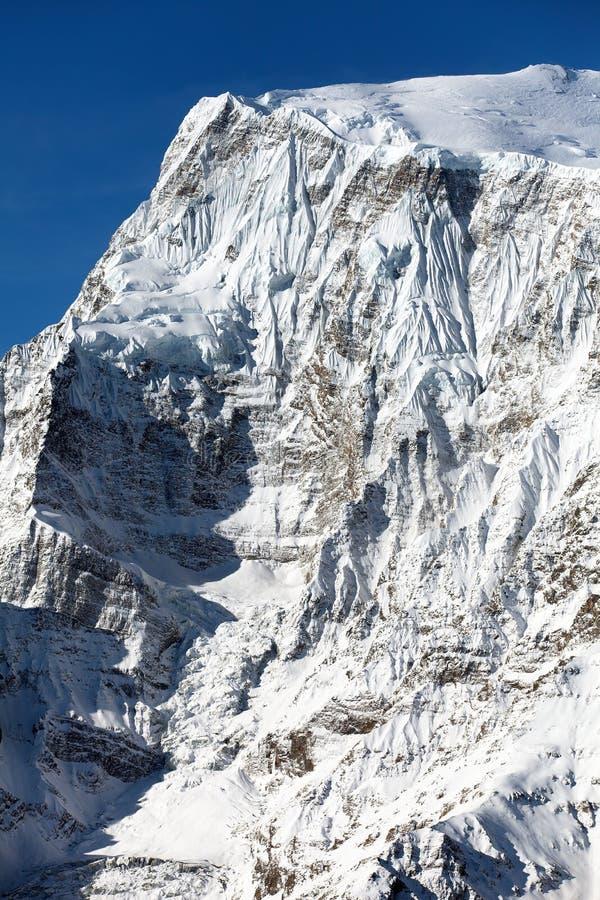 Cara del norte de la roca del soporte Annapurna 3 III foto de archivo