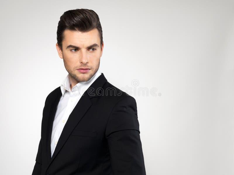 Cara del primer de un hombre de negocios de la moda en traje foto de archivo