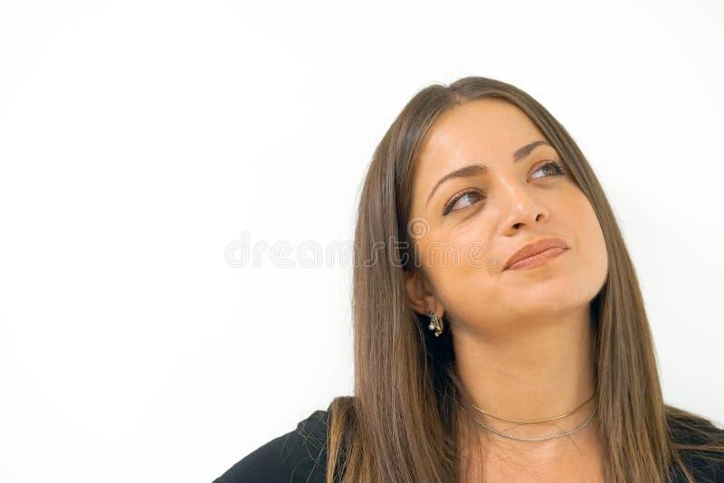 Cara del primer de una muchacha emocionada en perfil aislante imagen de archivo