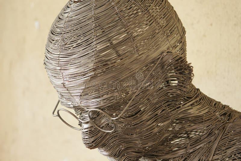 Cara del ` s de Gandhi enmarcada con la secuencia hecha del acero fotos de archivo libres de regalías