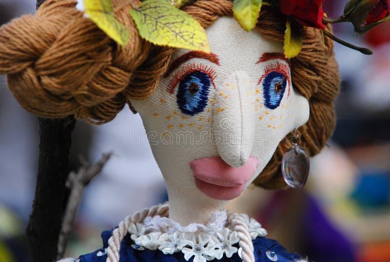 Cara divertida de la muñeca fotografía de archivo libre de regalías